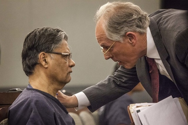 Defense attorney Richard Wright, right, talks to Dr. Dipak Desai during the doctor's sentencing, Thursday, Oct. 24, 2013, at Regional Justice Center in Las Vegas. (Jeff Scheid/Las Vegas Review-Jou ...
