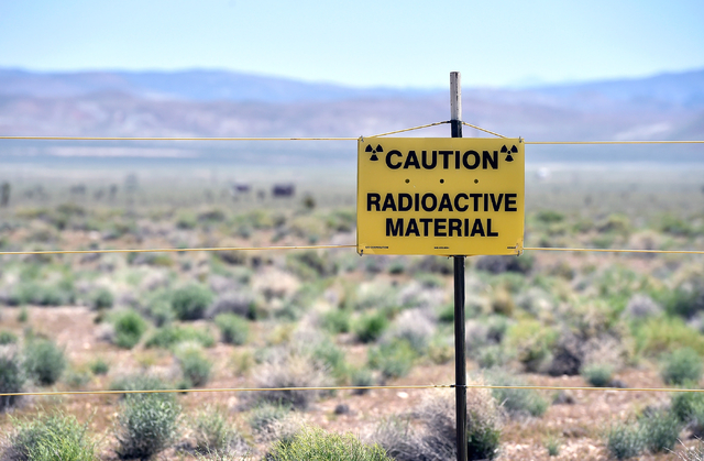 A warning sign is displayed at the Counter-Terrorism Operations Support training facility near the blast site from the 1955 Apple-2 nuclear bomb test at the Nevada National Security Site on Wednes ...