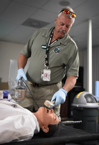 "Stu Estibo monitors a ""victim"" for radiation exposure during a decontamination exercise at the Counter-Terrorism Operations Support at the Nevada National Security Site on Wednesday, April 20, 201 ..."