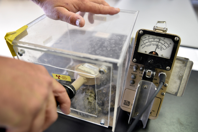 Brian Richardson, operation support supervisor, demonstrates using survey equipment with a sample of radioactive material collected from the 1955 Apple-2 nuclear blast bomb site. (David Becker/Las ...