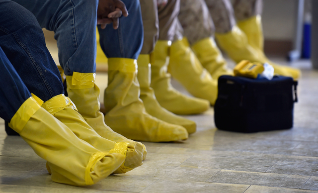 Students wearing protective footwear sit as they review procedures before field work at the Counter-Terrorism Operations Support training facility at the Nevada National Security Site on Wednesday ...
