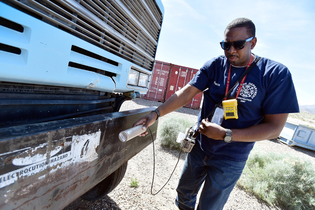 Student Gerry Tarver of the Tulsa, Okla., Fire Department surveys for radioactive material at the Nevada National Security Site on Wednesday, April 20, 2016.  (David Becker/Las Vegas Review-Journa ...