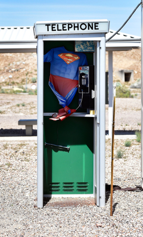 A Superman costume is seen hanging inside a telephone booth at the Counter-Terrorism Operations Support training facility at the Nevada National Security Site on Wednesday, April 20, 2016.  (David ...