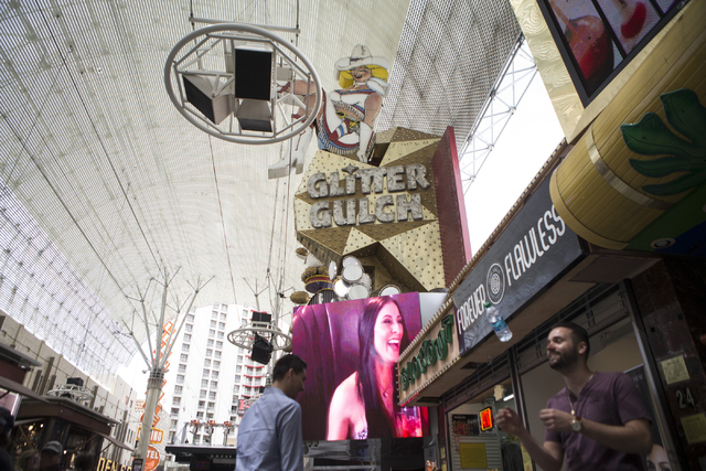 Topless Girls of Glitter Gulch at the Fremont Street Experience is seen on Thursday, April 21, 2016, in Las Vegas. The owners of the D Las Vegas and Golden Gate purchased the Topless Girls of Glit ...