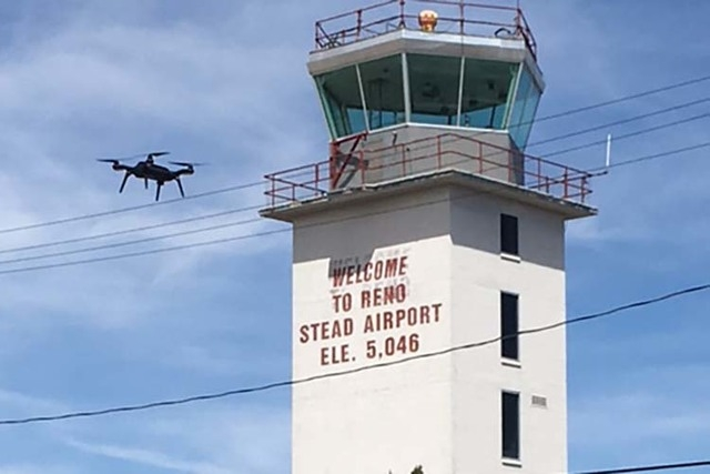 A drone flies near the Reno-Stead airport tower during an air traffic exercise on April 19, 2016. (Chris Walach)