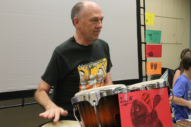 Brian Gardner plays the congas at a percussion and drum circle April 2 at the Green Valley Library. Gardner has collected drums from around the world and demonstrated how each one sounds. Michael  ...
