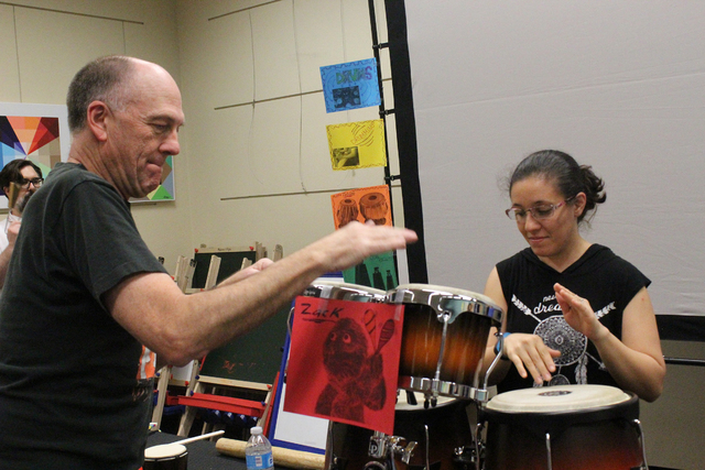 Brian Gardner shows Leidy Lester how to maintain a beat on the congas during an April 2 drum circle at the Green Valley Library, 2797 N. Green Valley Parkway. Michael Lyle/View
