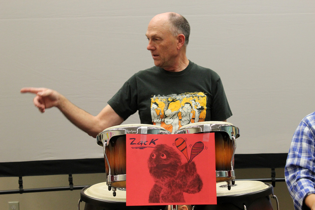 Brian Gardner gets the drum circle started at an event April 2 at Green Valley Library, 2797 N. Green Valley Parkway. The event featured a variety of percussion instruments from all over the world ...