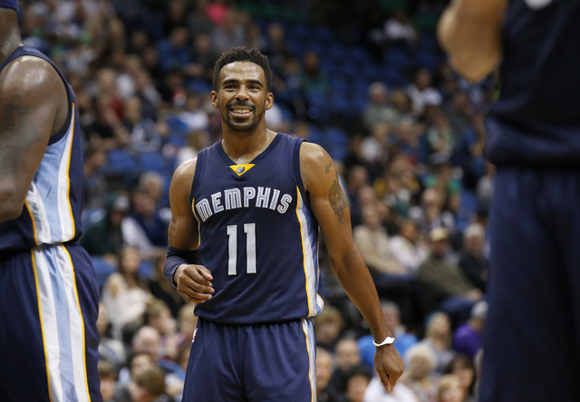 Memphis Grizzlies guard Mike Conley (11) smiles during the second half of a game against the Minnesota Timberwolves in Minneapolis. (Ann Heisenfelt/The Associated Press)