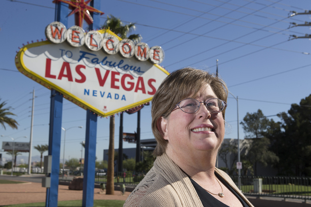 Lisa Lynn Chapman, communications coordinator for the Nevada Network Against Domestic Violence, poses for a portrait at the Welcome to Fabulous Las Vegas sign on S. Las Vegas Boulevard on Tuesday, ...