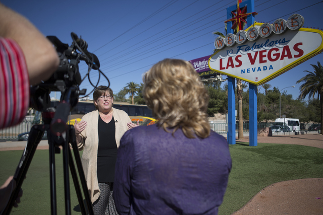 Lisa Lynn Chapman, communications coordinator for the Nevada Network Against Domestic Violence, is interviewed at the Welcome to Fabulous Las Vegas sign on S. Las Vegas Boulevard Tuesday, April 12 ...
