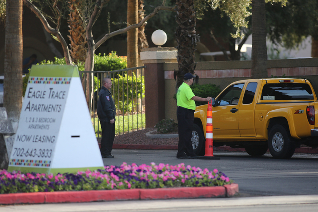 Security guards screen cars as they enter Eagle Trace Apartments near Nellis Air Force Base in northeast Las Vegas on Friday, April 22, 2016. (Brett Le Blanc/Las Vegas Review-Journal) Follow @bleb ...