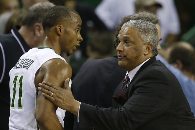 New Mexico State basketball coach Marvin Menzies, right, shakes hands with Baylor guard Lester Medford (11), left, following of an NCAA college basketball game, Wednesday, Dec. 23, 2015, in Waco,  ...