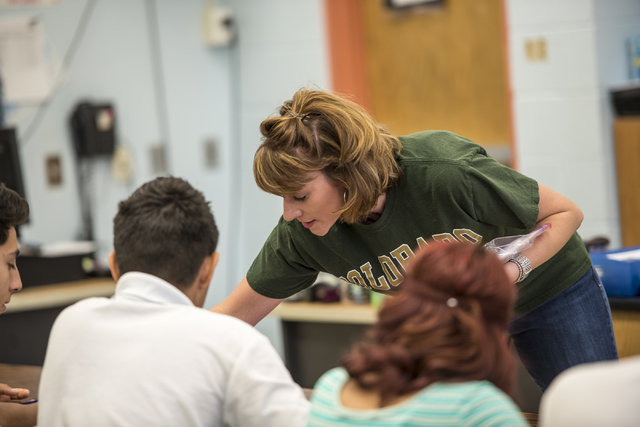 Science teacher Rebecca De Young works with students during class at Global Community High School in Las Vegas on Wednesday, April 20, 2016. Global Community High School specializes in students tr ...