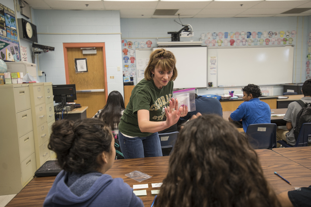 Science teacher Rebecca De Young high fives students during class at Global Community High School in Las Vegas on Wednesday, April 20, 2016. Global Community High School specializes in students tr ...