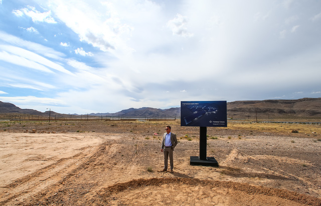 Faraday Future Vice President of Manufacturing Dag Reckhorn waits for others during the groundbreaking for the company's planned 900-acre manufacturing site in North Las Vegas on Wednesday, April  ...