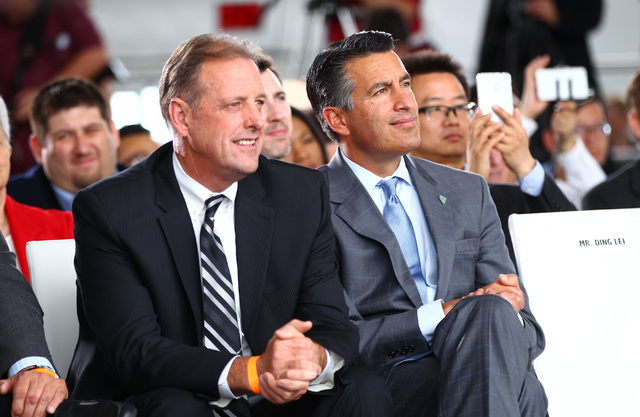 North Las Vegas Mayor John Lee, left, and Gov. Brian Sandoval listen during the groundbreaking for Faraday Future's planned 900-acre manufacturing site in North Las Vegas on Wednesday, April 13, 2 ...