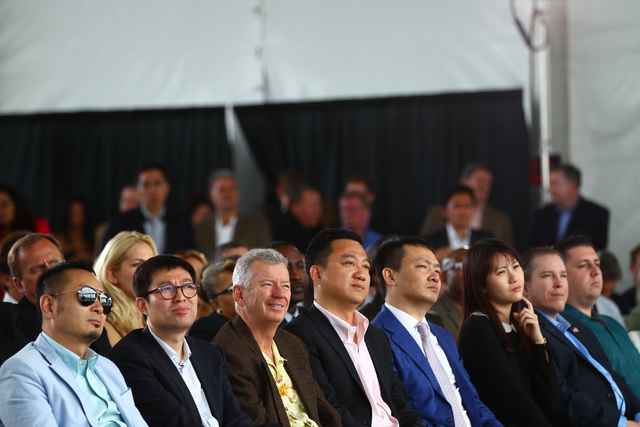 People listen to speakers during the groundbreaking for Faraday Future's planned 900-acre manufacturing site in North Las Vegas on Wednesday, April 13, 2016. Chase Stevens/Las Vegas Review-Journal ...