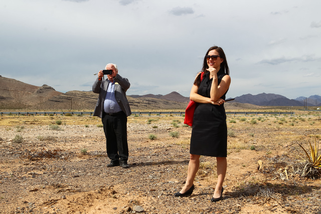 People look on during the groundbreaking for Faraday Future's planned 900-acre manufacturing site in North Las Vegas on Wednesday, April 13, 2016. Chase Stevens/Las Vegas Review-Journal Follow @cs ...