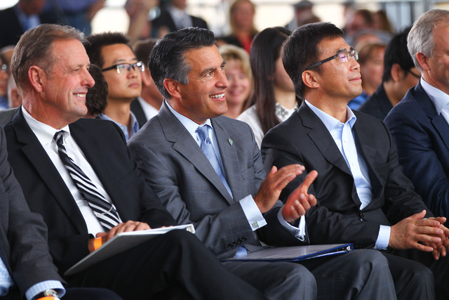 North Las Vegas Mayor John Lee, from left, Gov. Brian Sandoval, and Ding Lei, co-founder and global vice chairman of SEE Plan, listen during the groundbreaking for Faraday Future's planned 900-acr ...