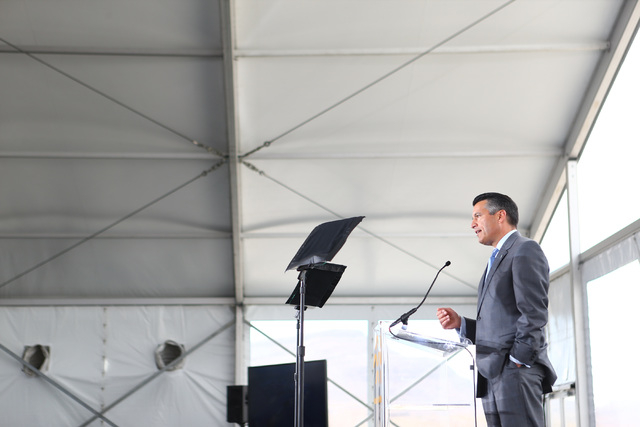 Gov. Brian Sandoval speaks during the groundbreaking for Faraday Future's planned 900-acre manufacturing site in North Las Vegas on Wednesday, April 13, 2016. Chase Stevens/Las Vegas Review-Journa ...