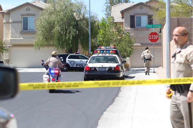 Police work at the scene of an officer involved shooting at 9848 Fast Elk St., near Iron Mountain Road and North El Capitan Way in the far northwest valley on Thursday, March 31, 2016. (Rachel Cro ...