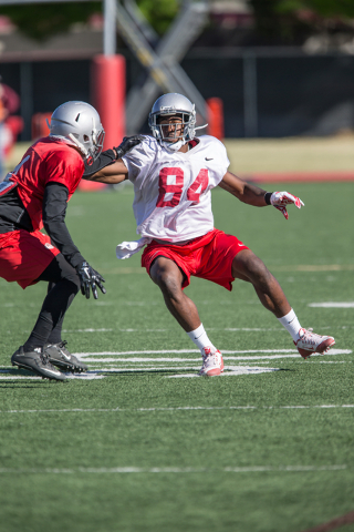UNLV junior wide receiver Kendal Keys (84) and senior defensive back Torry McTyer (4) make contact during a practice at UNLV's Rebel Park on Friday, April 1, 2016, in Las Vegas. Donavon Lockett/La ...