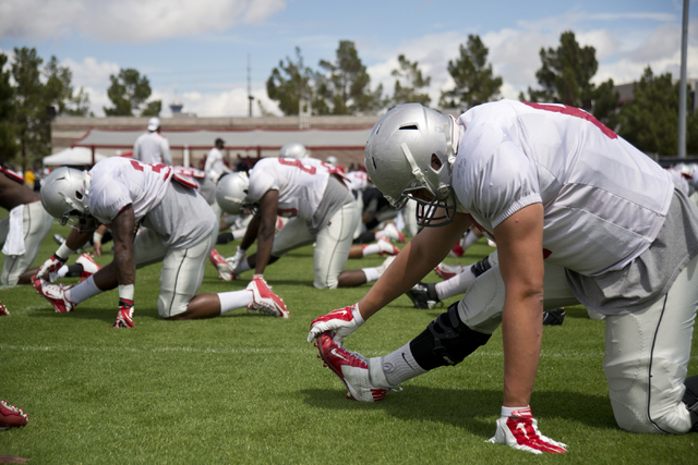 Chris Lopez (61) warms up during the Spring Showcase football event at Peter Johann Memorial Field on the UNLV campus in Las Vegas on Saturday, April 9, 2016. The event was cut short by heavy rain ...