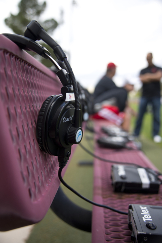 A headset rests on a bench during the Spring Showcase football event at Peter Johann Memorial Field on the UNLV campus in Las Vegas on Saturday, April 9, 2016. The event was cut short by heavy rai ...