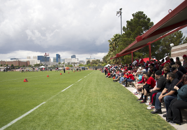 A large crowd looks on at the during the Spring Showcase football event at Peter Johann Memorial Field on the UNLV campus in Las Vegas on Saturday, April 9, 2016. The event was cut short by heavy  ...