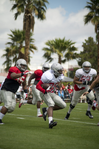 Keith Whitely (28) runs the ball during the Spring Showcase football event at Peter Johann Memorial Field on the UNLV campus in Las Vegas on Saturday, April 9, 2016. The event was cut short by hea ...