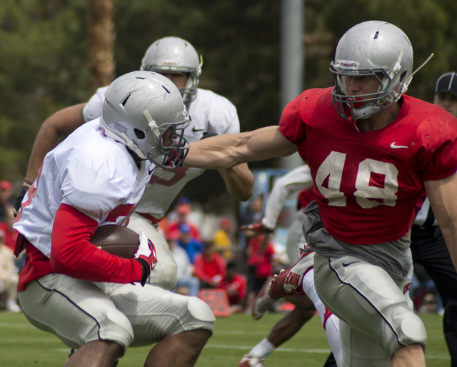 Keith Whitely (28) and Bailey Laolagi (48) come face to face during the Spring Showcase football event at Peter Johann Memorial Field on the UNLV campus in Las Vegas on Saturday, April 9, 2016. Th ...