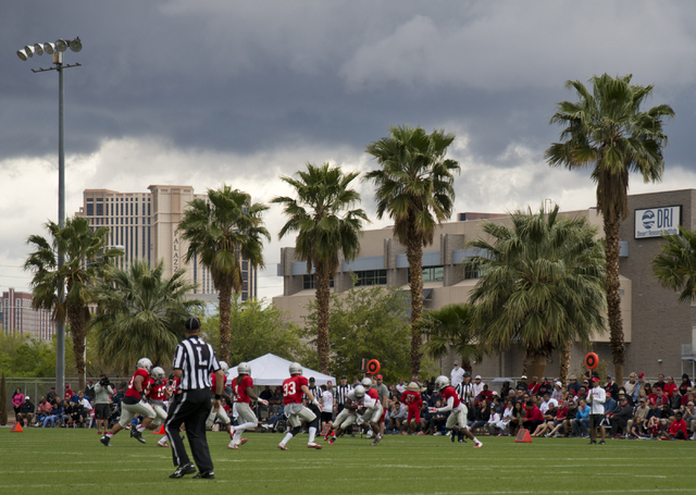 A storm brews above the Spring Showcase football event at Peter Johann Memorial Field on the UNLV campus in Las Vegas on Saturday, April 9, 2016. The event was cut short by heavy rain and lightnin ...