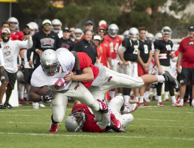Keith Whitely (28) is tackled during the Spring Showcase football event at Peter Johann Memorial Field on the UNLV campus in Las Vegas on Saturday, April 9, 2016. The event was cut short by heavy  ...