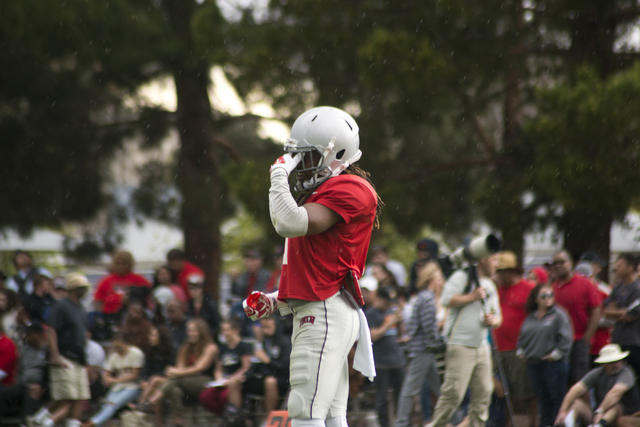 Jay'Onn Myles (1) stands in the rain during the Spring Showcase football event at Peter Johann Memorial Field on the UNLV campus in Las Vegas on Saturday, April 9, 2016. The event was cut short by ...