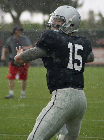Quarterback Christian Lopez (15) warms up in the rain during the Spring Showcase football event at Peter Johann Memorial Field on the UNLV campus in Las Vegas on Saturday, April 9, 2016. The event ...