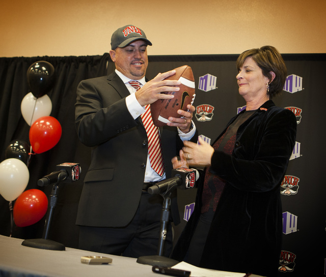 UNLV Athletics Tina Kunzer-Murphy, right, introduced Tony Sanchez as UNLV's Men's football coach, Thursday, Dec. 11,2014, at Stan Fulton Building.  Sanchez, former Bishop Gorman High School coach, ...