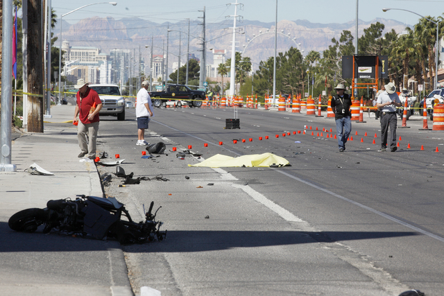 The scene where a moped rider died after being struck by a car near East Flamingo and Pecos roads Sunday, April 3, 2016, in Las Vegas. (Rachel Aston/Las Vegas Review Journal) Follow @rookie__rae
