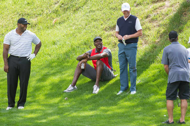 From left, Dwight Freeney, Michael Jordan and Wayne Gretzky watch as Chris Chelios prepares to hit the ball on the 8th hole during the Michael Jordan Celebrity Invitational at Shadow Creek Golf Co ...