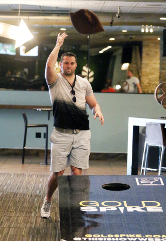 David Klics, of Warren New Jersey, plays Cornhole at Gold Spike Tuesday, March 22, 2016, in Las Vegas. Gold Spike, with new design and ownership by Downtown Project, will celebrate its third year  ...