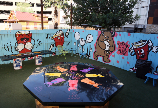A playing area for beer pong is shown at Gold Spike Tuesday, March 22, 2016, in Las Vegas. Gold Spike, with new design and ownership by Downtown Project, will celebrate its third year this May. Ro ...