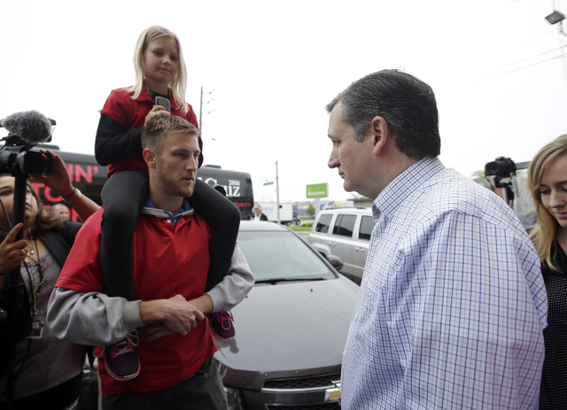 Republican presidential candidate Sen. Ted Cruz, R-Texas, speaks with a patron during a campaign stop at Sister's Place Restaurant, Wednesday, April 27, 2016, in Indianapolis. (Darron Cummings/AP)
