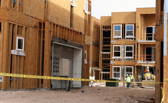 Yellow crime scene tape is seen at a construction site where a security guard was found dead by Las Vegas police in the 5100 block of Jerry Tarkanian Way on Wednesday, April 27, 2016. (Bizuayehu T ...