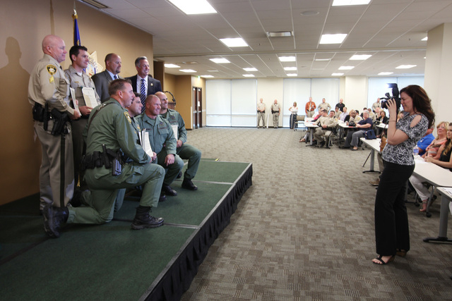 Metro officers have their photo taken during Metro's commendation ceremony Wednesday, April 22, 2015. This group received a unit meritorious award for their actions involving a home invasion and a ...
