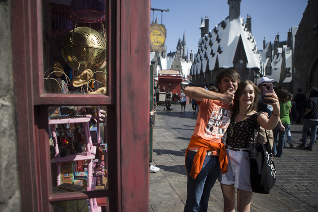 Two people who declined to give their name pose for a photo inside the The Wizarding World of Harry Potter at Universal Studios on Friday, March 18, 2016, in Universal City, Calif. Erik Verduzco/L ...