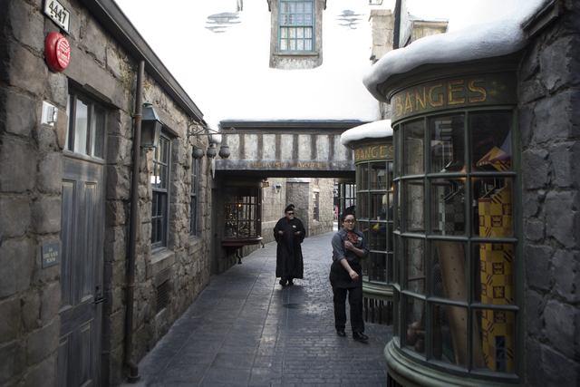 Two people walk in an alley inside The Wizarding World of Harry Potter at Universal Studios on Friday, March 18, 2016, in Universal City, Calif. Erik Verduzco/Las Vegas Review-Journal Follow @Erik ...