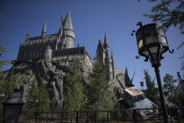Hogwarts Castle, which houses the Harry Potter and the Forbidden Journey 3-D ride, is seen inside The Wizarding World of Harry Potter at Universal Studios on Friday, March 18, 2016, in Universal C ...