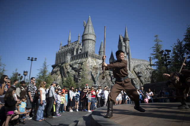 Performers entertain the crowd inside The Wizarding World of Harry Potter at Universal Studios on Friday, March 18, 2016, in Universal City, Calif. Erik Verduzco/Las Vegas Review-Journal Follow @E ...