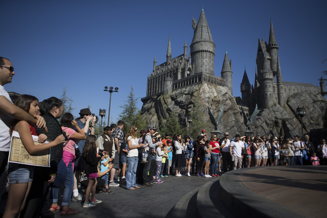 A crowd wait for a performance inside The Wizarding World of Harry Potter at Universal Studios on Friday, March 18, 2016, in Universal City, Calif. Erik Verduzco/Las Vegas Review-Journal Follow @E ...