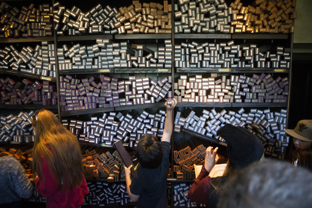 People browse wands inside the Ollivanders shop inside The Wizarding World of Harry Potter at Universal Studios on Friday, March 18, 2016, in Universal City, Calif. Erik Verduzco/Las Vegas Review- ...